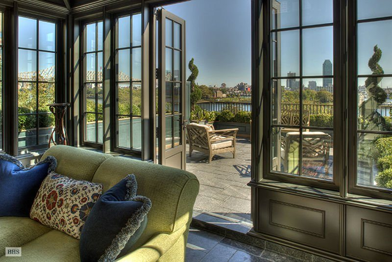 gorgeous-french-doors-open-up-onto-a-terrace-with-views-of-the-skyline